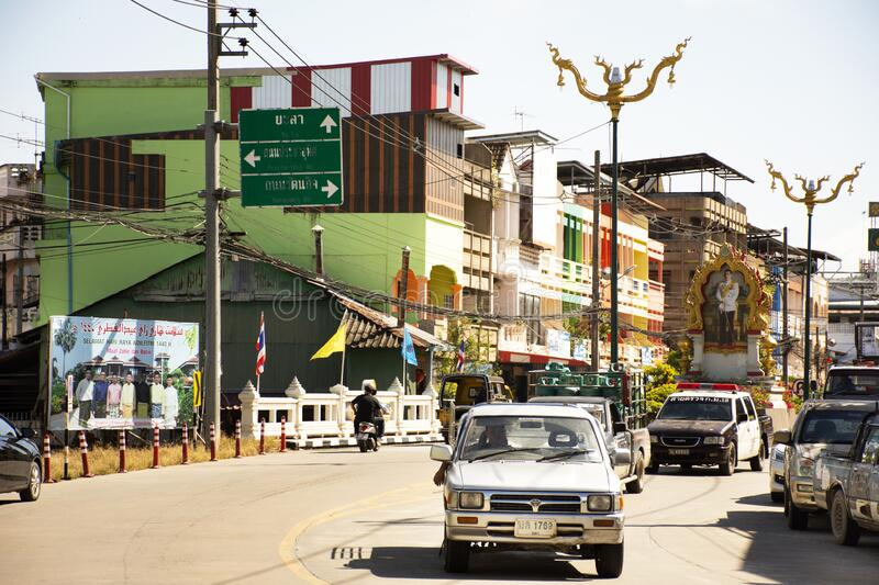 Thai people and foreign traveler drive car and ride motorcycle and bike bicycle on traffic road at southern city of thai on August. BETONG YALA, THAILAND stock images