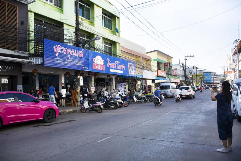 Thai people and foreigner travelers go to eating breakfast in local restaurant with traffic road in Udon Thani, Thailand. Thai people and foreigner travelers go royalty free stock photo