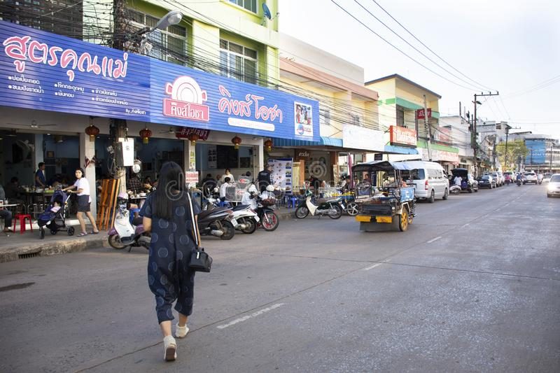 Thai people and foreigner travelers go to eating breakfast in local restaurant with traffic road in Udon Thani, Thailand. Thai people and foreigner travelers go royalty free stock images