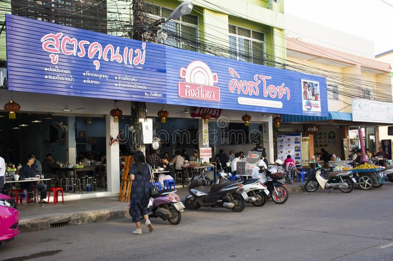 Thai people and foreigner travelers go to eating breakfast in local restaurant with traffic road in Udon Thani, Thailand. Thai people and foreigner travelers go stock photo
