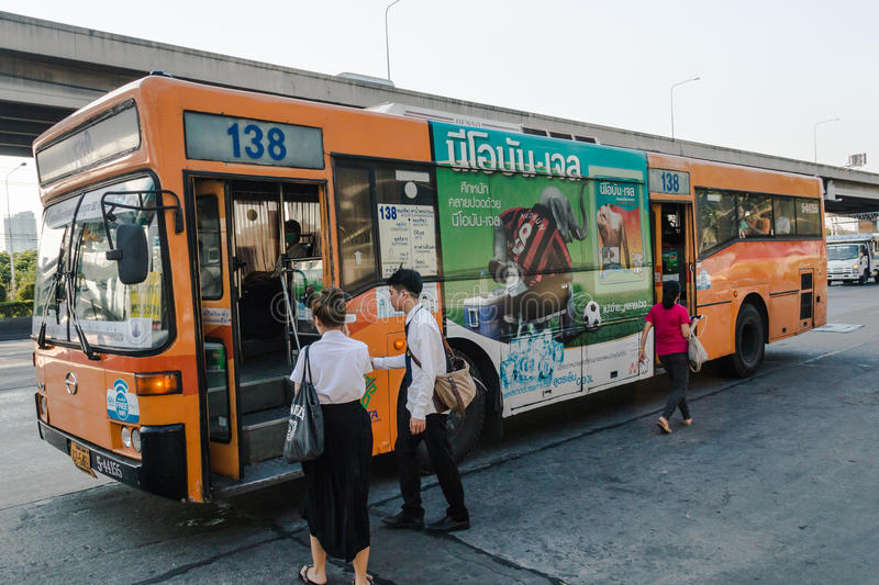 Thai people get on a bus royalty free stock images