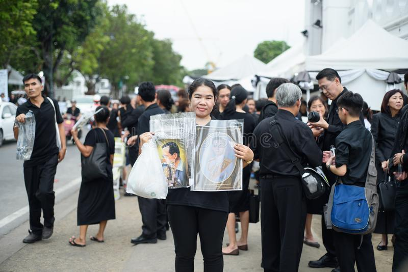 Thai people grieve over the demise of King Rama9. BANGKOK,THAILAND-DEC5,2016:The death of Thai beloved king rama9 on 13 October,2016 makes the people being in royalty free stock photo