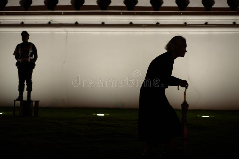 Thai people grieve over the demise of King Rama9. BANGKOK,THAILAND-DEC5,2016:The death of Thai beloved king rama9 on 13 October,2016 makes the people being in royalty free stock photography