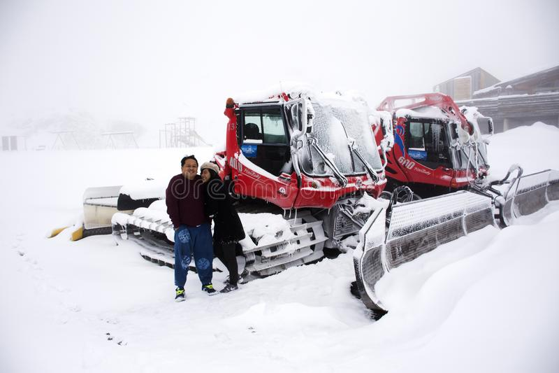 Thai people husband and wife travel and posing for take photo with Snowploughs machine stock image