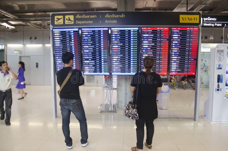 Thai people looking information board check flight passengers ar. Riving and departing of Suvarnabhumi international airport on December 11, 2016 in Bangkok royalty free stock images