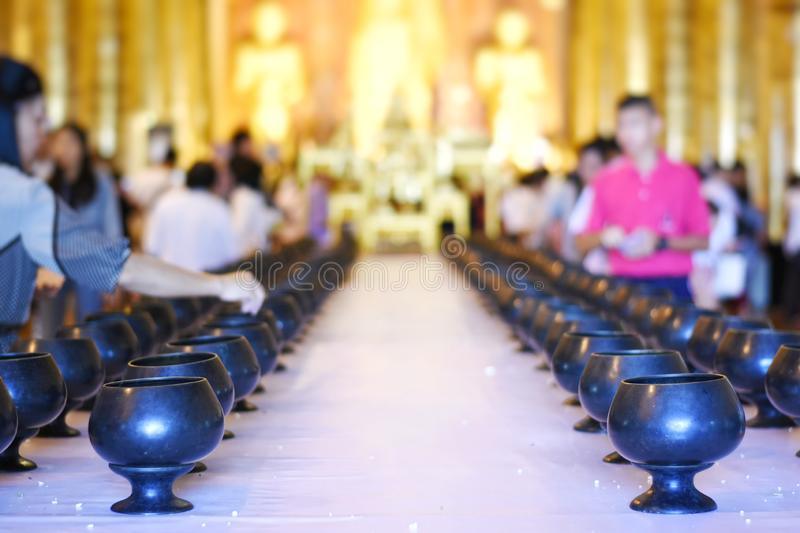 Thai people made the merit in the building of a temple for illustration Buddhism ceremony concept. Selective focus and bright perspective image of Thai people stock photo