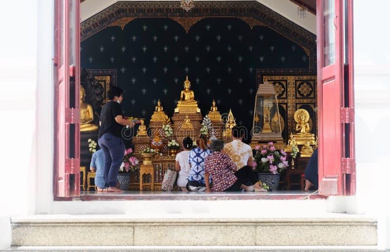 Thai People Make Merit with The Buddha. Bangkok, Thailand - March 5, 2019 : Thai People Worship, Pay Respect and Make Merit with The Buddha in The Temple stock photo