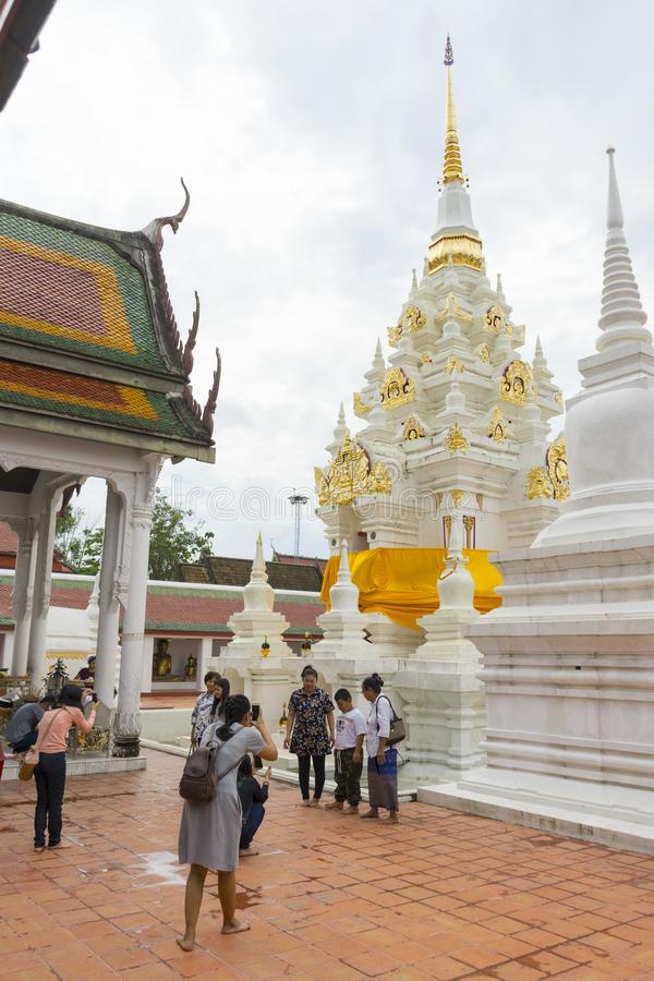 Thai people make a merit inside Wat Phra Borommathat Chaiya in Chaiya in Surat Thani, Thailand. Surat Thani, Thailand - Dec 31,2018 : Thai people make a merit stock images