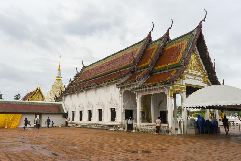 Thai people make a merit inside Wat Phra Borommathat Chaiya in Chaiya in Surat Thani, Thailand. royalty free stock photography