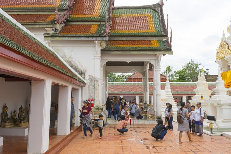 Thai people make a merit inside Wat Phra Borommathat Chaiya in Chaiya in Surat Thani, Thailand. Surat Thani, Thailand - Dec 31,2018 : Thai people make a merit royalty free stock image