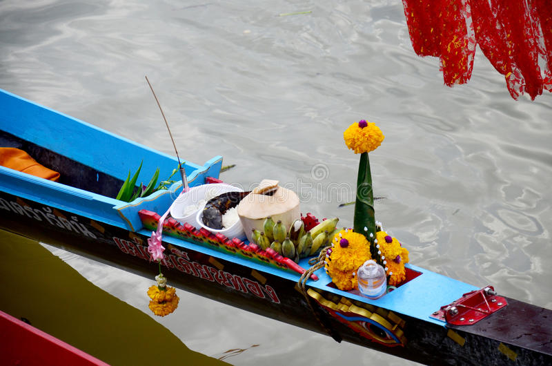 Thai people offerings dedicated or sacrifices for boat nymph or guardian goddess of boats. Before Long Boat Racing Festival at chao phraya river on November 8 royalty free stock image