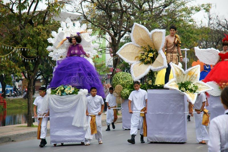 Thai people on the parade in ChiangMai Flower Festival 2013. CHIANGMAI, THAILAND - FEBRUARY 2-2013 : Unidentified Thai people on the parade in ChiangMai Flower royalty free stock photo