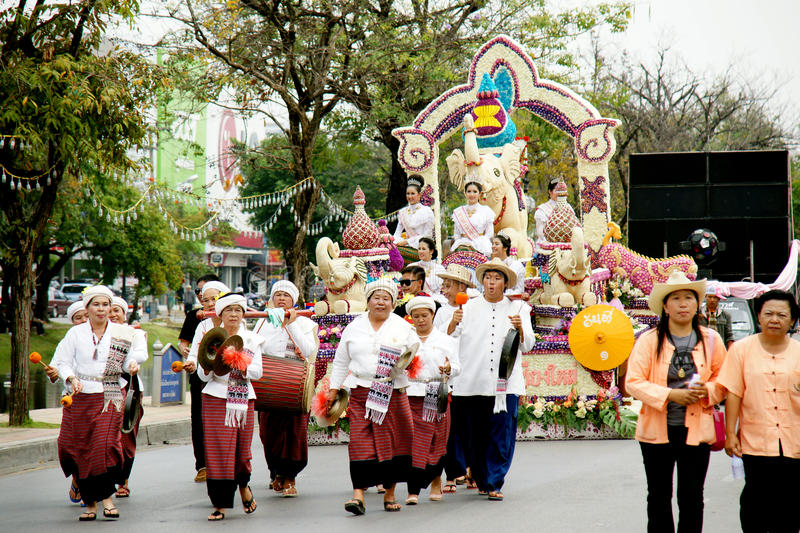 Thai people on the parade in ChiangMai Flower Festival 2013. CHIANGMAI, THAILAND - FEBRUARY 2-2013 : Unidentified Thai people on the parade in ChiangMai Flower royalty free stock image