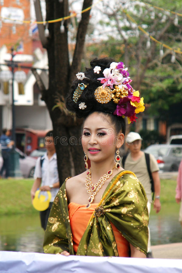 Thai people on the parade in ChiangMai Flower Festival 2013. CHIANGMAI, THAILAND - FEBRUARY 2-2013 : Unidentified Thai people on the parade in ChiangMai Flower stock image