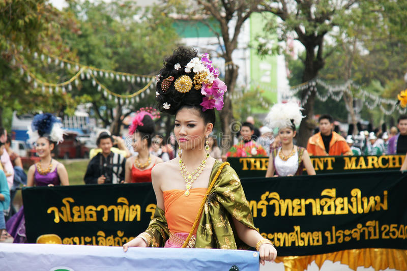 Thai people on the parade in ChiangMai Flower Festival 2013. CHIANGMAI, THAILAND - FEBRUARY 2-2013 : Unidentified Thai people on the parade in ChiangMai Flower stock images