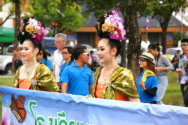 Thai people on the parade in ChiangMai Flower Festival 2013. CHIANGMAI, THAILAND - FEBRUARY 2-2013 : Unidentified Thai people on the parade in ChiangMai Flower royalty free stock images