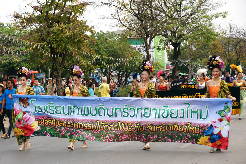 Thai people on the parade in ChiangMai Flower Festival 2013. CHIANGMAI, THAILAND - FEBRUARY 2-2013 : Unidentified Thai people on the parade in ChiangMai Flower stock photography