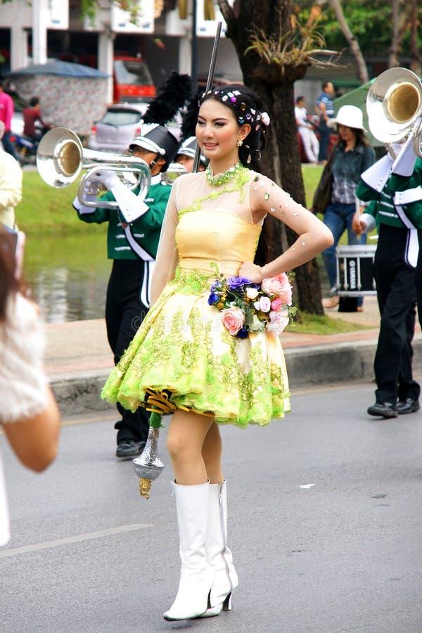 Thai people on the parade in Chiangmai Flower Festival 2013. CHIANGMAI, THAILAND - FEBRUARY 2-2013 : Unidentified Thai people on the parade in ChiangMai Flower royalty free stock photos
