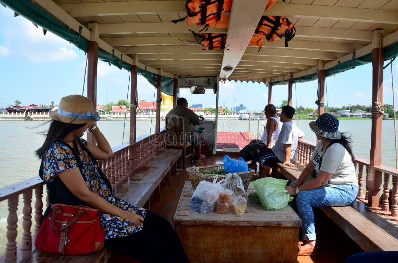 Thai people passenger ferry boat crossover Chaopraya river. At Wat Bangchak Temple on November 21, 2015 in Nonthaburi, Thailand royalty free stock photo