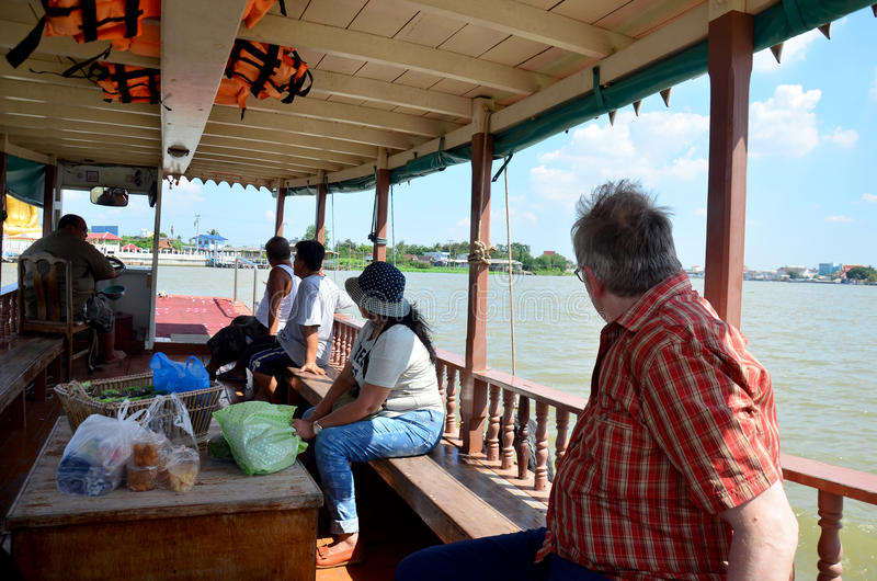 Thai people passenger ferry boat crossover Chaopraya river. At Wat Bangchak Temple on November 21, 2015 in Nonthaburi, Thailand royalty free stock photos