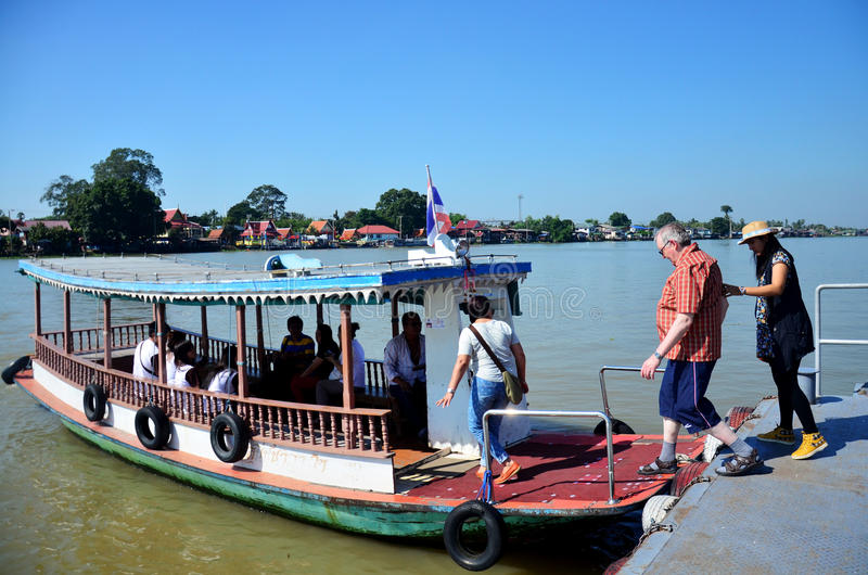 Thai people passenger ferry boat crossover Chaopraya river. At Wat Bangchak Temple on November 21, 2015 in Nonthaburi, Thailand stock photo