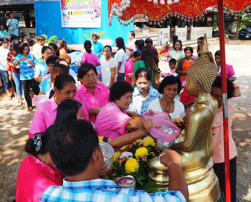 Thai people pay respect to the Buddha, Songkran fe. BAN NA SAN - SURAT THANI PROVINCE - THAILAND - APRIL 11, 2014: Thai people pay respect and bathe the Buddha royalty free stock image