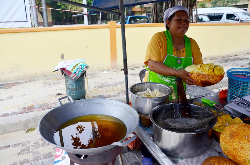 Thai people peeling Champedak or Artocarpus integer sale for peo. Ple at market on September 18, 2018 in Nakhon Si Thammarat, Thailand stock photos