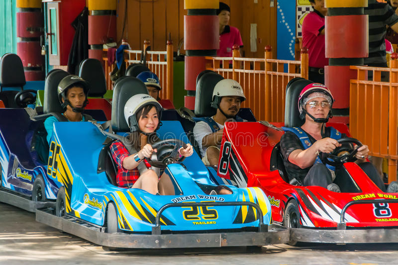 Thai people perpare for a go-kart race. BANGKOK, THAILAND - 10 MAY 2013: Thai people perpare for a go-kart race at Dream World on May 10, 2013. Dream world is a stock image