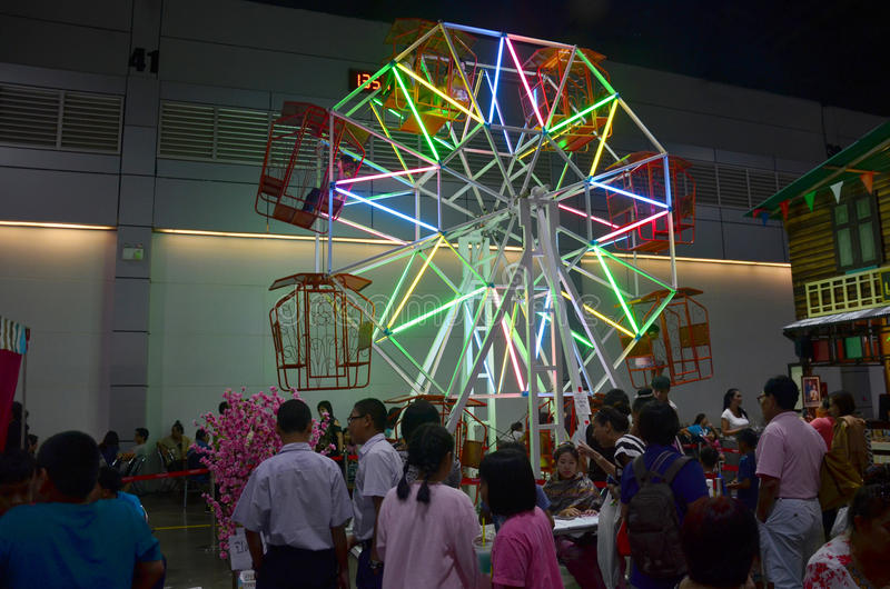 Thai people playing ferris wheel in temple carnival retro. At IMPACT Muang Thong Thani on October 16, 2015 in Nonthaburi, Thailand stock images
