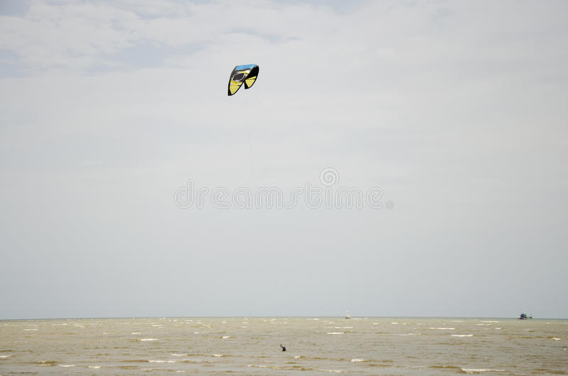Thai people playing Kite Surf with wind and wave on the sea. At Laem Charoen beach and Mae Pim beach in Rayong, Thailand stock image