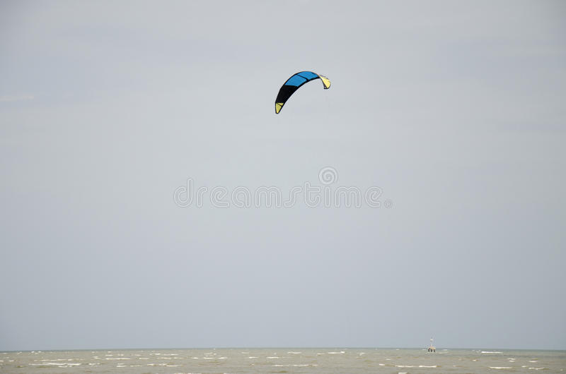 Thai people playing Kite Surf with wind and wave on the sea. At Laem Charoen beach and Mae Pim beach in Rayong, Thailand royalty free stock photography