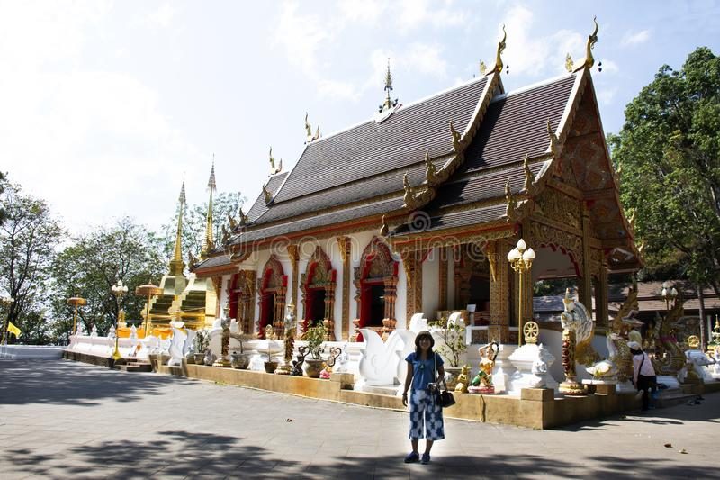 Thai people posing for take photo at Wat Phra That Doi Tung in Chiang Rai, Thailand. Thai people posing travel visit and respect praying chedi or Stupa and stock photography