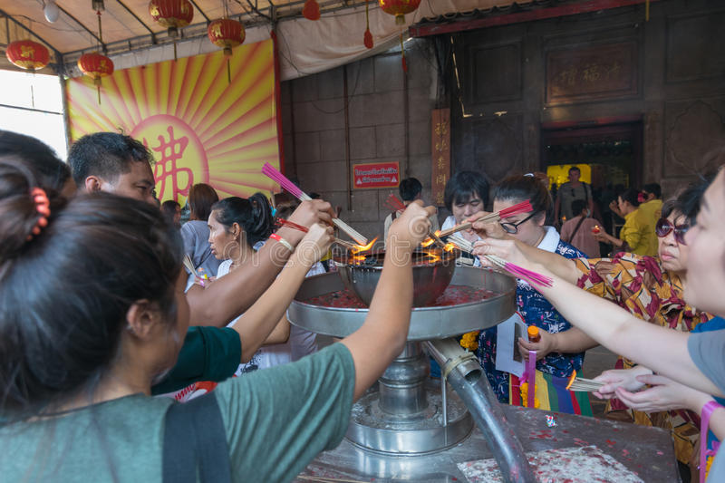 Thai people pray in Chinese temple. Bangkok, Thailand - March 6, 2016 : Thai people pray in temple at Wat Mangkon Kamalawat (Wat Leng Noei Yi). Wat Leng Noei Yi stock images