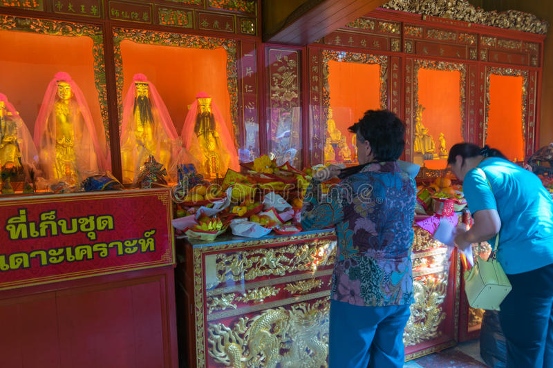Thai people pray in Chinese temple. Bangkok, Thailand - March 6, 2016 : Thai people pray in temple at Wat Mangkon Kamalawat (Wat Leng Noei Yi). Wat Leng Noei Yi royalty free stock photography