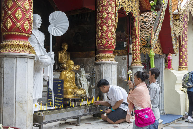Thai people praying in temple. Chiang Mai, Thailand July 2016 stock image