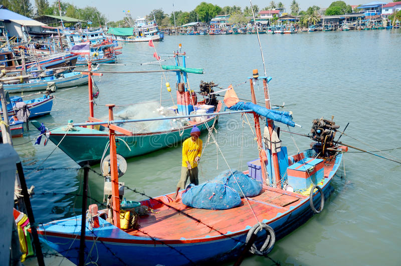 Thai people prepare fishing boat for fishing in night time at fishing village. On December 9, 2015 in Phetchaburi, Thailand royalty free stock photo
