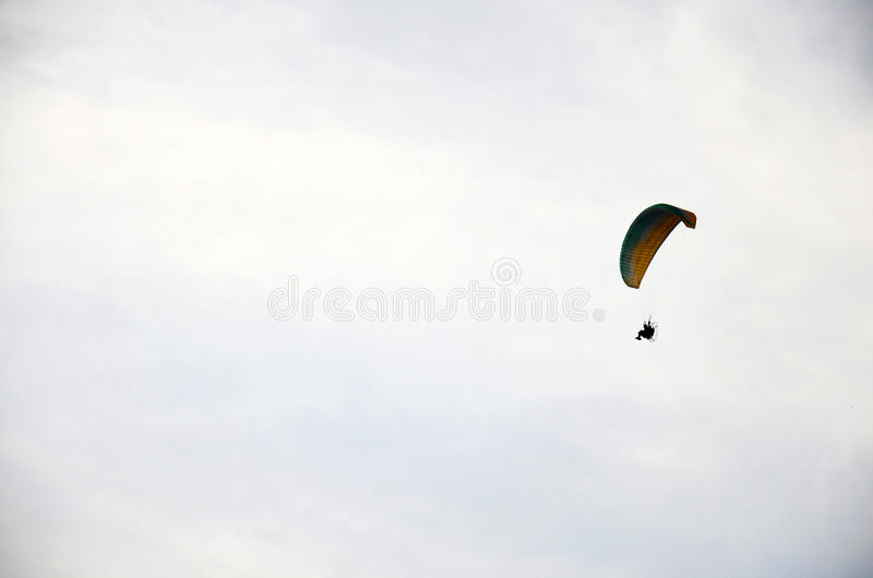 Thai people riding paramotor flying around phu thai world day fe. Stival at Ban Non Hom on January 16, 2016 in Sakon Nakhon, Thailand royalty free stock photography