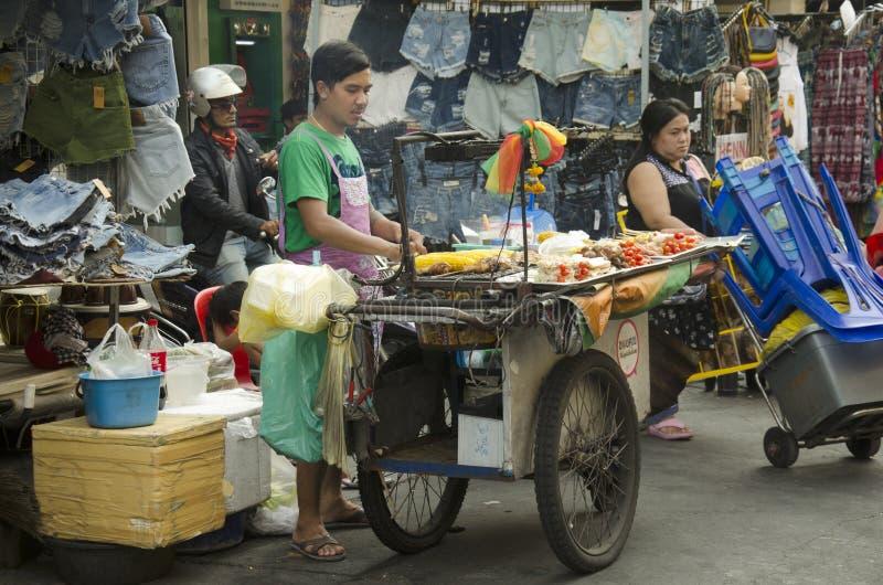 Thai people sale food at Khaosan Road. On March 19, 2016 in Bangkok, Thailand royalty free stock photo