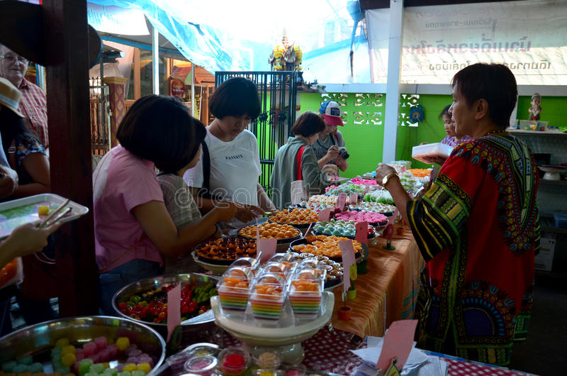 Thai people select and shopping Auspicious Thai Desserts snack. At Koh Kret Island on November 21, 2015 in Nonthaburi, Thailand royalty free stock photo