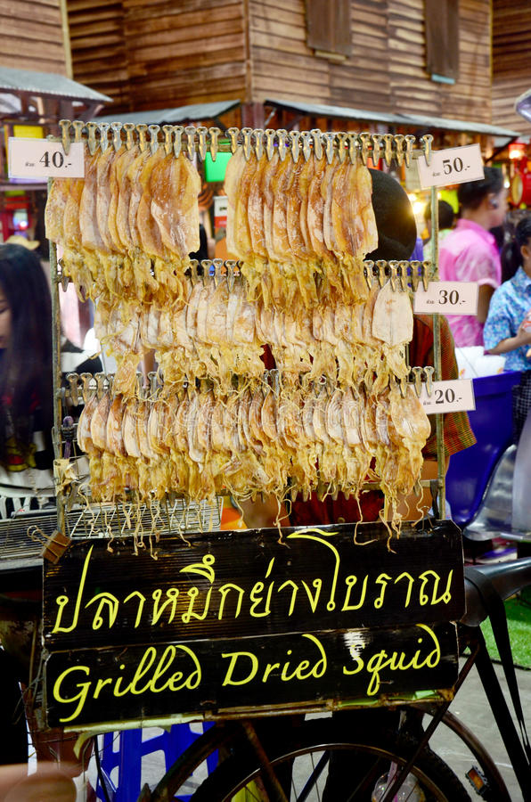 Thai people sell grilled dried squid in temple carnival retro. At IMPACT Muang Thong Thani on October 16, 2015 in Nonthaburi, Thailand stock photo