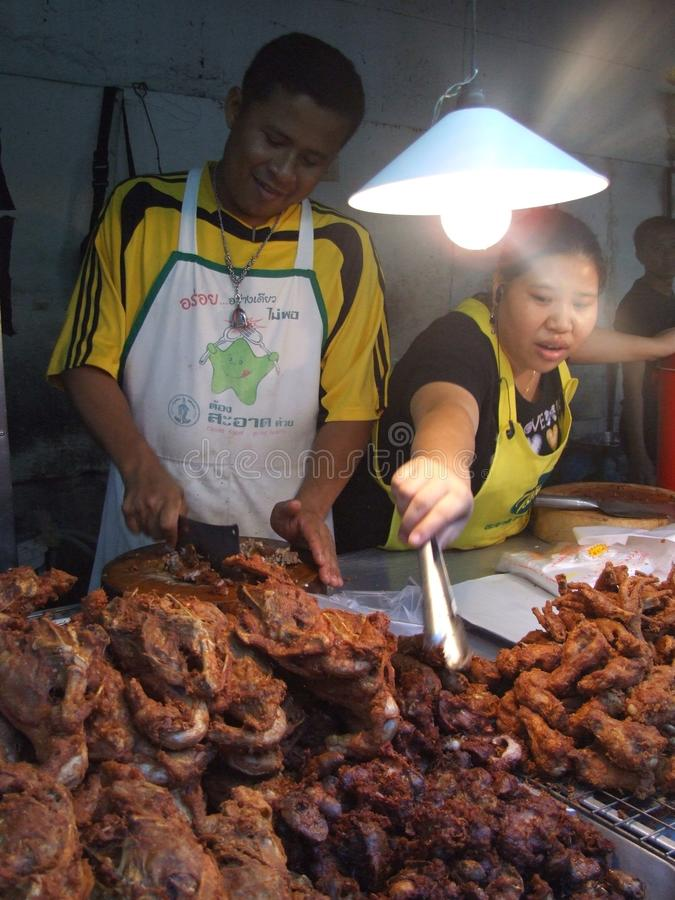 Thai people selling meat, Bangkok. BANGKOK, THAILAND - MAY 18: Thai people selling deep fried ducks. May 18, 2005 in Bangkok royalty free stock image