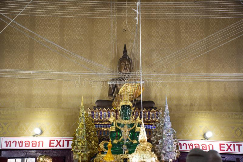 Thai people respect praying for blessing from Luang Phor Pak Daeng buddha statue at Wat Prommanee in Nakhon Nayok, Thailand. Thai people traveler respect praying royalty free stock photography