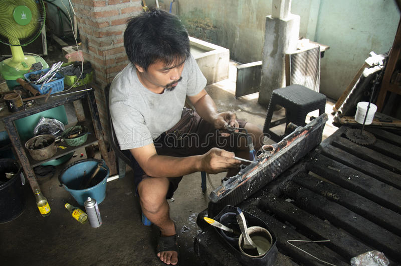 Thai people use lead and gas welding for fix and solder radiator royalty free stock images