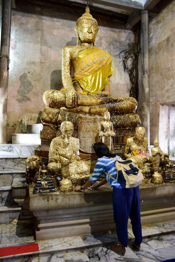 Thai people visit travel and resepct praying with old buddha statue. In ubosot of Wat Bang Kung at Bang Kung Sub-district in Bang Khontee District of Samut royalty free stock photo