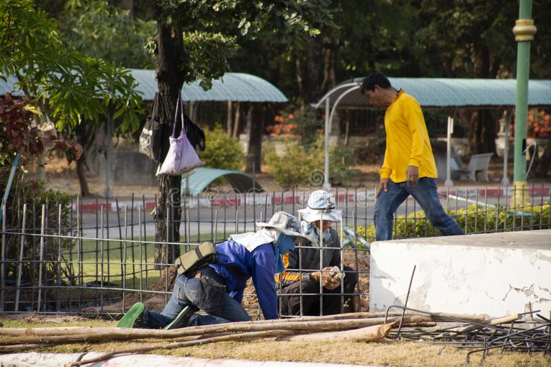 Thai people worker knitting metal rods bars into framework reinforcement for concrete pouring at construction site royalty free stock photos