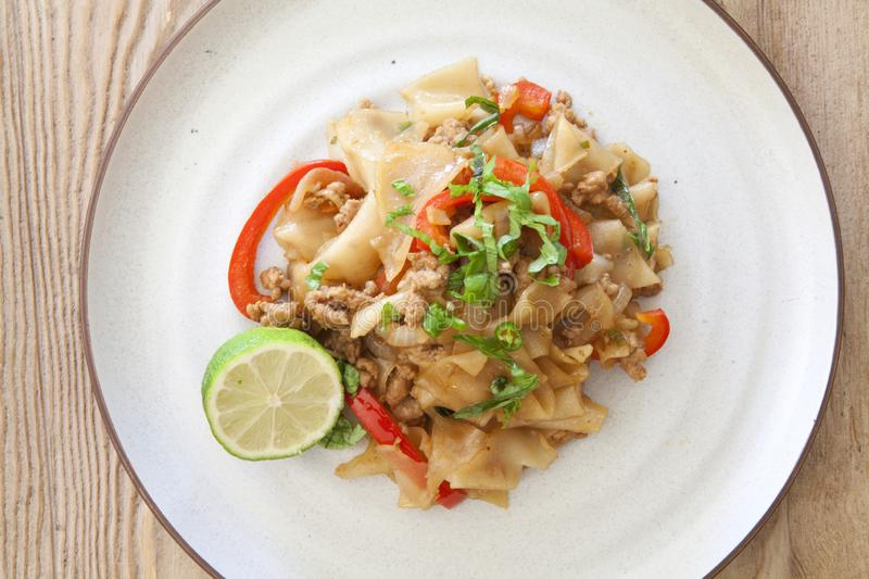 Thai Phad See Ew. Phad See Ew Noodles on a wooden table royalty free stock photography