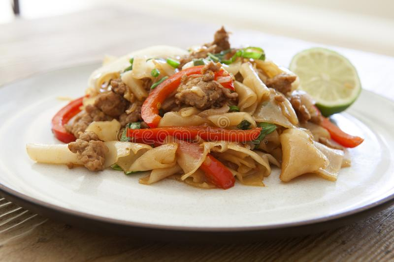 Thai Phad See Ew. Phad See Ew Noodles on a wooden table stock photography