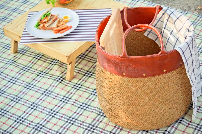 Thai picnic basket in summer at thailand. Thai basket and accessories, tablecloth, wooden table, healthy food royalty free stock photography
