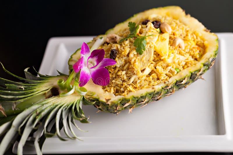 Thai Pineapple Fried Rice. Freshly prepared pineapple fried rice served inside of a pineapple carved like a bowl royalty free stock photos