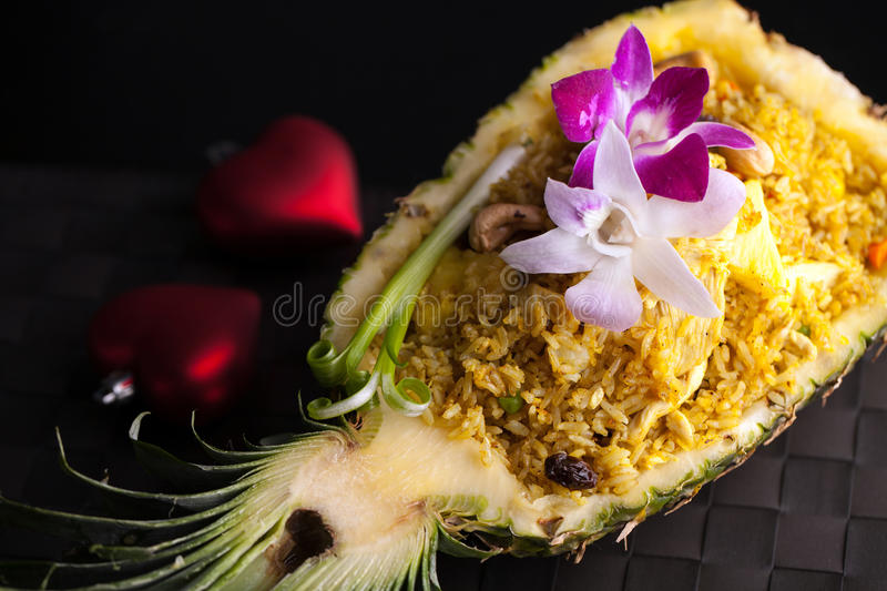 Thai Pineapple Fried Rice. Freshly prepared pineapple fried rice served inside of a pineapple carved like a bowl stock images